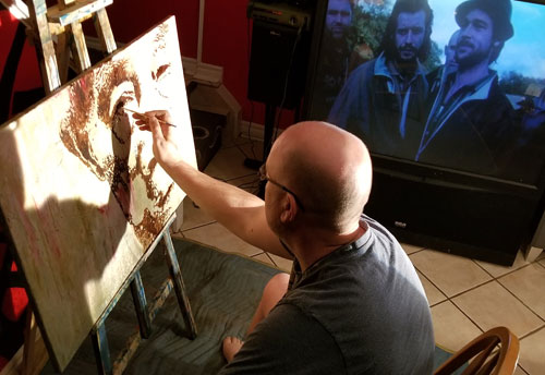 Todd Peterson working on his painting of Fu